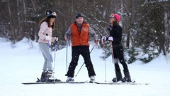 Young twins and adult man with ski standing at the hill Stock Footage