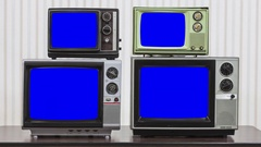 Four Vintage Televisions with Zoom into Chroma Key Blue Screen Stock Footage