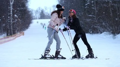 Young twins with ski stand at the hill Stock Footage