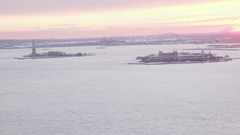 Panning from Statue of Liberty to Commuipaw Terminal from Rooftop Sunset Stock Footage