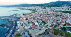 Evening flight over Rethymno city at Crete Stock Footage