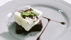 Chocolate dessert - Brown. Cake with ice cream on a white plate Stock Footage