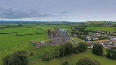 The aerial view of the Rock of Cashel and the green fields in Ireland Stock Footage