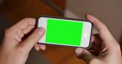 Man Uses Blank Green Screen Smartphone to Play a Game  	 Stock Footage