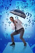 Uncertainty concept with businessman and question marks Stock Photos