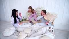 Mom, Dad Daughter Fooling Fight Around in Bed in the Morning Stock Footage