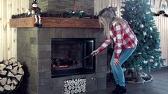 Woman raking up the fire Stock Footage
