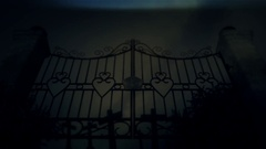 Spooky Old Metal Gate Under a Lightning Storm and Rain Stock Footage
