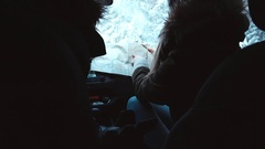 Friends traveling by car in winter, looking for the right way on the map Stock Footage