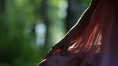 Fairy girl in forest touches her dress Stock Footage