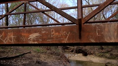 Kids names carved on a rusty bridge Stock Footage