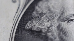 Tracking macro of George Washington's face on the US one dollar bill Stock Footage