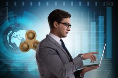 Businessman with key in hardworking concept Stock Photos