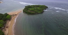 Aerial Footage of Beach Town Shoreline and Island in Bali, Indonesia Stock Footage
