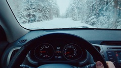 Driver's POV point of view looking through car windshield of snowy road Stock Footage