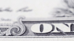 Tracking macro elements on the US one dollar bill. US dollars background Stock Footage