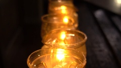Candles in low light ambient in a church Stock Footage