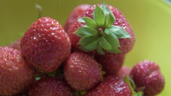 Taking fresh strawberry from the plate Stock Footage