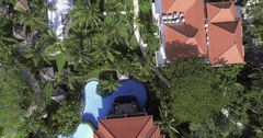 Aerial Close Up of Resort and Pool at Beach Town in Bali, Indonesia Stock Footage