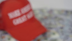 Make America Great Again Rack Focus to Hat and Money Stock Footage