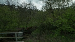 Timelapse view from riding train window of coutryside landscape, trees, forests Stock Footage