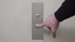 DOWN Silver Elevator Button with Wallpaper Stock Footage