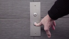 DOWN Silver Elevator Button with Slate Tile Stock Footage