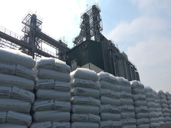 Rows of stacked bags of fertilizers silos tank storage Stock Footage