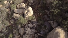 Looking Down at Trails in Boulders Stock Footage