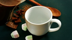 Cup of hot chocolate, cinnamon sticks, marshmallows Stock Footage