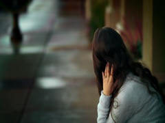 Girl sitting on a bench and  straightens the hair Stock Footage