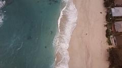 Aerial look down of waves crashing on beach in Hawaii 01 Stock Footage