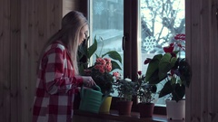 Young woman watering flowers with pot Stock Footage