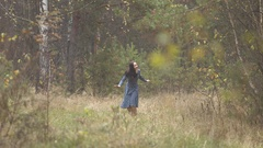 Girl is walks in the forest. Stock Footage