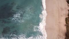 Aerial look down of waves crashing on beach in Hawaii 02 Stock Footage