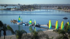 Sailboats rest in Mission Bay, San Diego, California. Stock Footage