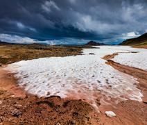 Summer snow in the Krafla volcano. Stock Photos