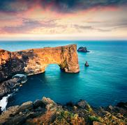 Dramatic evening scene of Dyrholaey arch. Stock Photos