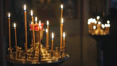 Burning candles in an Orthodox Church. Icons and prayer Stock Footage