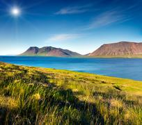 Typical Icelandic landscape with volcanic mountains and pure water river. Stock Photos
