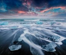Blocks of ice washed by the waves on Jokulsarlon beach Stock Photos