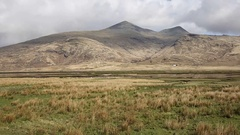 Isle of Mull Scotland UK rural countryside scene with Ben More mountains pan Stock Footage