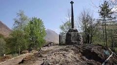 Glencoe monument in village in Glen Coe Scottish Highlands Scotland UK Stock Footage