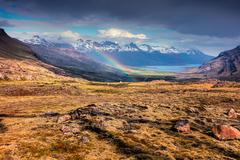 Light rain and the rainbow in the Icelandic mountains. Stock Photos