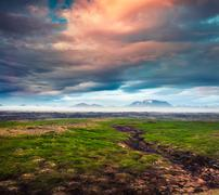 Typical Icelandic landscape with foggy mountains on the horizon. Stock Photos