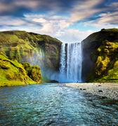 Colorful summer scene with flowing water of Skogafoss Waterfall Stock Photos