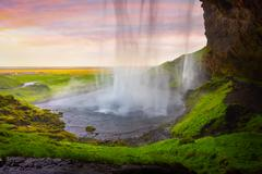 Colorful evening view from the middle of famous Seljalandfoss Waterfall. Stock Photos