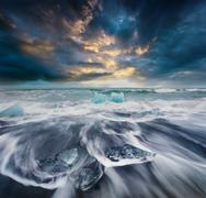 Blocks of ice washed by the waves on Jokulsarlon beach. Stock Photos