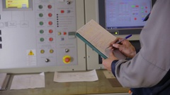 Engineer hands writing information from industrial electronic control board Stock Footage
