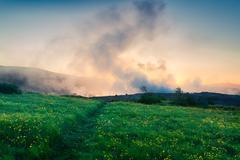 Foggy summer sunrise in Great Geysir valley Stock Photos